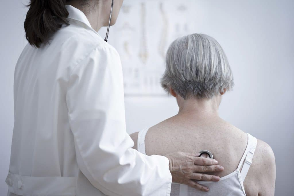 Senior with Pneumonia being cared for by doctor in Kitchener-Waterloo